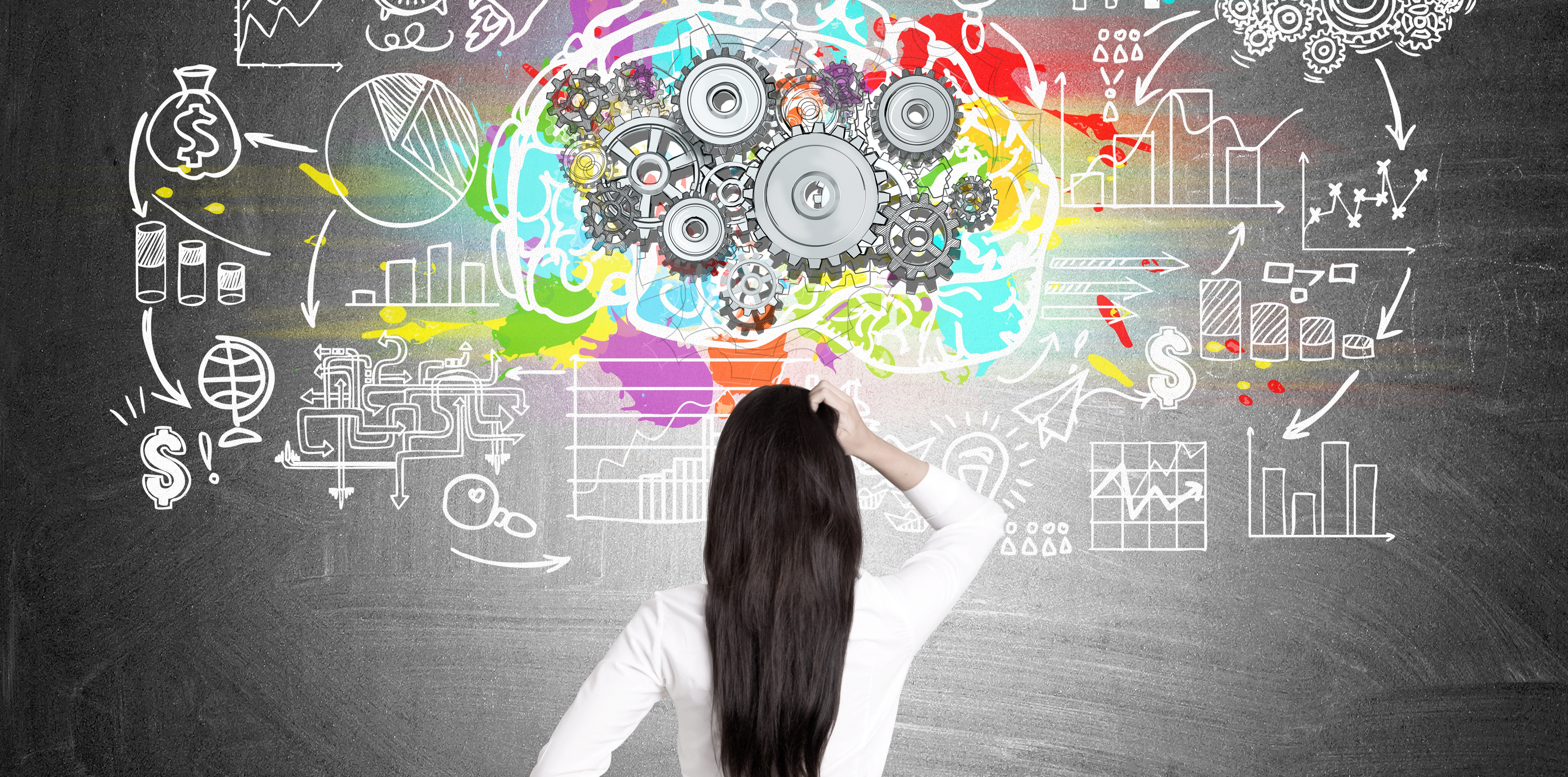 girl looking at board of tech.jpg